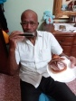 A crazy old guy named Felix with his Harmonica and a brioss