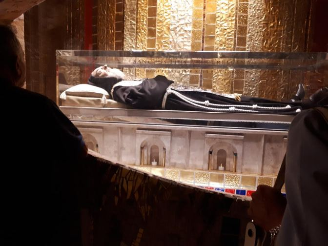 Padre Pio, people cry, pray to, and leave lots of money at his dead body that then just gets taken by the church. It's an interesting view on religion...